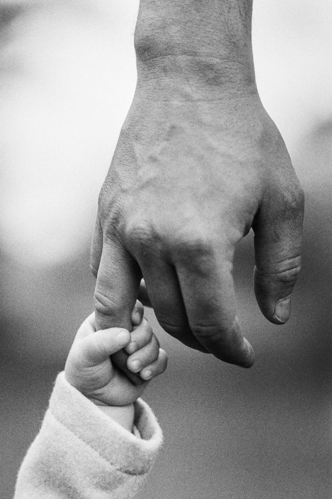 Father, Daughter. Holding Hands